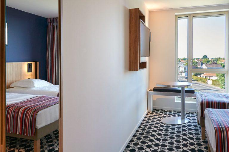 Découvrez les chambres familiales de notre hôtel Akena Nantes Aéroport.